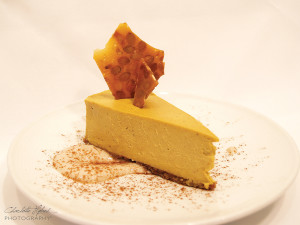 PUMPKIN CHEESECAKE WITH BOURBON-BROWN SUGAR CREAM